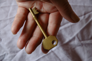 Hand with golden key